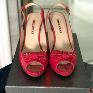 Prada like new in box patent pink wedges with logo
